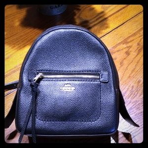 Coach black backpack can convert to cross body